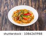 traditional asian noodle lagman | Shutterstock . vector #1086265988