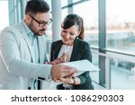 discussing documents in modern... | Shutterstock . vector #1086290303