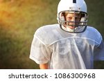 young boy in a football uniform ... | Shutterstock . vector #1086300968