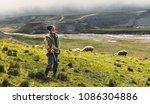 portrait of shepherd with sheep ... | Shutterstock . vector #1086304886
