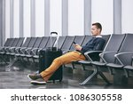 man traveling by airplane.... | Shutterstock . vector #1086305558