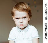 portrait of an angry child.... | Shutterstock . vector #1086307646