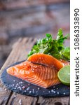 raw salmon fillets with parsley ... | Shutterstock . vector #1086333890
