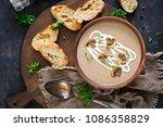mushroom cream soup. vegan food.... | Shutterstock . vector #1086358829