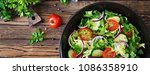 salad from tomatoes  cucumber ... | Shutterstock . vector #1086358910