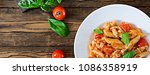 penne pasta in tomato sauce... | Shutterstock . vector #1086358919