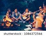 friends enjoying music near... | Shutterstock . vector #1086372566