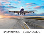 wing view runway at the airport ... | Shutterstock . vector #1086400373