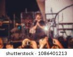 blurred artist performs songs... | Shutterstock . vector #1086401213
