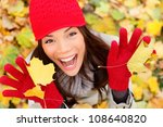Happy Autumn Woman Playing In...