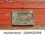 gone fishing sign written on a...   Shutterstock . vector #1086420398
