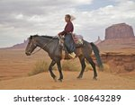 Navajo Woman On Horseback In...