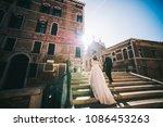 handsome groom kissing happy... | Shutterstock . vector #1086453263