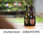 two bottles of don perignon on... | Shutterstock . vector #1086455390