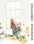 girl florist at work. a... | Shutterstock . vector #1086457610