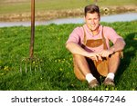 handsome blond bavarian man... | Shutterstock . vector #1086467246