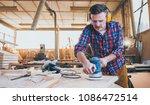 carpenter at work polishing... | Shutterstock . vector #1086472514