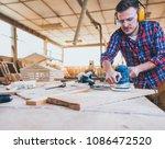 carpenter at work polishing... | Shutterstock . vector #1086472520