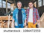 carpenters standing proud in... | Shutterstock . vector #1086472553