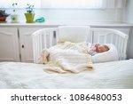 newborn baby girl having a nap... | Shutterstock . vector #1086480053