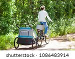 young mother riding bicycle... | Shutterstock . vector #1086483914