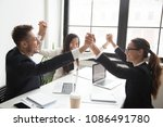 happy multiracial team holding... | Shutterstock . vector #1086491780
