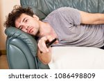 lazy man with the remote on the ... | Shutterstock . vector #1086498809