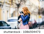 a young redhaired caucasian... | Shutterstock . vector #1086504473