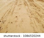 Small photo of trace of wheels on the sand