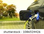 ev car or electric car at... | Shutterstock . vector #1086524426