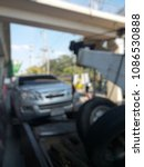 Small photo of Blurred a police department tow truck are towing bronze vehicle are broken on the road to prevent the danger of accidental duplications and delivers to the garage