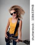 Female Rockstar Playing Guitar...