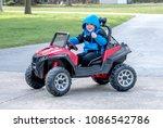 a cute little boy poses as he... | Shutterstock . vector #1086542786