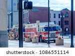Small photo of march 17 2018 south bend IN; firetrucks roar into the city with sirens blaring as they respond to a 911 fire call down town