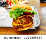 burger with tomato  onion in an ...