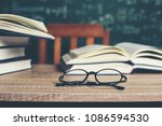 book with green board... | Shutterstock . vector #1086594530