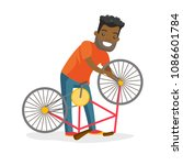 black man working in the bike...   Shutterstock .eps vector #1086601784