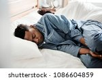 a couple sleeping back to back | Shutterstock . vector #1086604859