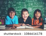 pupils  reading a book in the... | Shutterstock . vector #1086616178