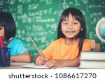 two girl with crayon drawing at ... | Shutterstock . vector #1086617270