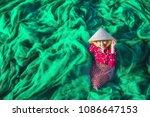 Young Vietnamese Woman Sitting...