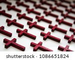 Small photo of A collection of wooden crosses to depict the loss of life.