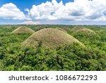 chocolate hills at bohol ...   Shutterstock . vector #1086672293