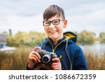 Boy Child Outdoors Holding An...