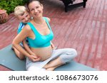 yoga classes. mother and son.... | Shutterstock . vector #1086673076