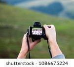 hands holding the digital photo ...   Shutterstock . vector #1086675224