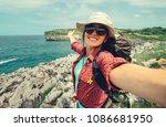 happy woman backpacker traveler ... | Shutterstock . vector #1086681950