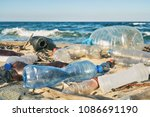 spilled garbage on the beach of ... | Shutterstock . vector #1086691190