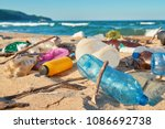 spilled garbage on the beach of ... | Shutterstock . vector #1086692738