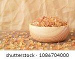 natural rock sugar in a wood...   Shutterstock . vector #1086704000